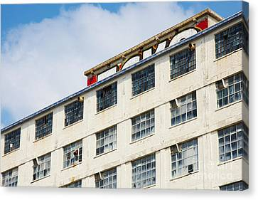 Canvas Print featuring the photograph Old Factory Under A Clear Blue Sky by Nick  Biemans