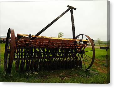 Old Farm Equipment Canvas Print by Jeff Swan