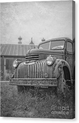 Old Farm Truck Out By The Barn Canvas Print by Edward Fielding