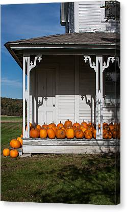 Old Farmhouse With Pumpkins On The Porch Canvas Print by Karen Stephenson