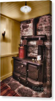 Old Fashioned Stove Canvas Print by Susan Candelario