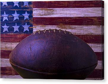 Old Football With Flag Canvas Print by Garry Gay