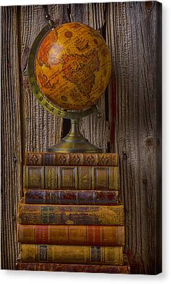 Book Collecting Canvas Print - Old Globe On Old Books by Garry Gay