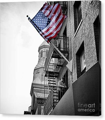 Old Glory Getting Raised Canvas Print by John Farnan