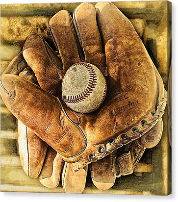Old Gloves Canvas Print by Ron Regalado