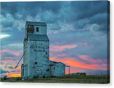 Old Granary With Sunset Clouds Canvas Print by Chuck Haney