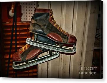 Old Hockey Skates Canvas Print by Paul Ward
