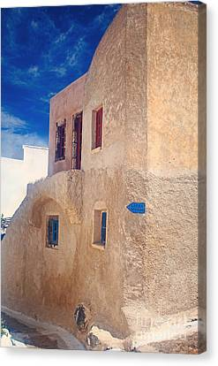 Old House In Oia  Canvas Print by Aiolos Greek Collections