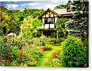 Old House With A Beautiful English Garden Canvas Print by Beverly Claire Kaiya