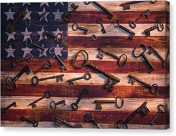 Old Keys On American Flag Canvas Print by Garry Gay