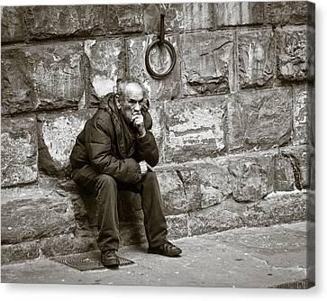 Old Man Pondering Canvas Print by Susan Schmitz