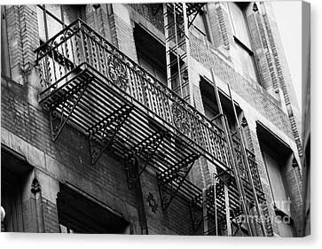 Old Metal Fire Escape Staircase On Side Of Building Greenwich Village New York City Canvas Print by Joe Fox