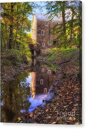 Old Mill Reflected In A Creek Canvas Print by George Oze
