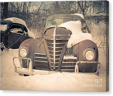 Old Plymouth Classic Car In The Snow Canvas Print by Edward Fielding