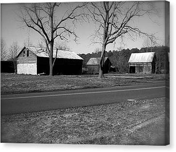 Canvas Print featuring the photograph Old Red Barn In Black And White by Amazing Photographs AKA Christian Wilson