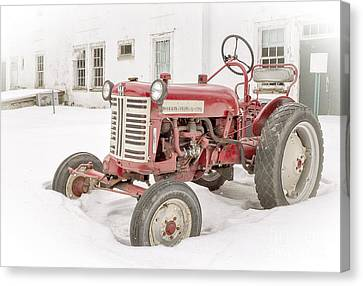 Old Red Tractor In The Snow Canvas Print by Edward Fielding