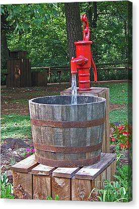 Canvas Print featuring the photograph Old Red Water Pump by Val Miller