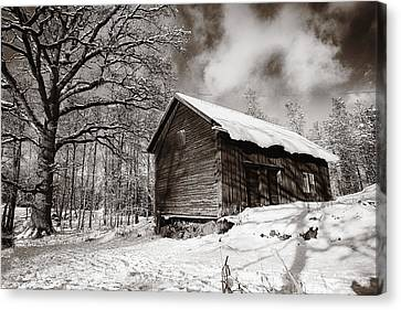 Canvas Print featuring the photograph Old Rural Barn In A Winter Landscape by Christian Lagereek
