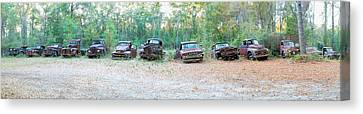 Old Rusty Cars And Trucks In A Field Canvas Print by Panoramic Images
