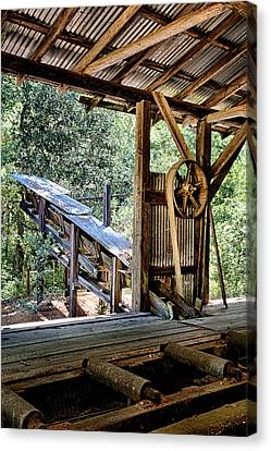 Old Sawmill Conveyor Canvas Print by Betty Depee