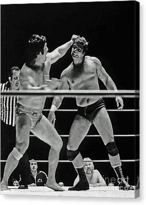 Canvas Print featuring the photograph Old School Wrestlers Dean Ho And Don Muraco Battling It Out In The Middle Of The Ring by Jim Fitzpatrick