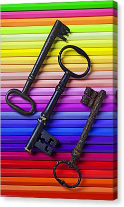 Old Skeleton Keys On Rows Of Colored Pencils Canvas Print
