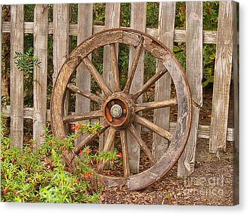 Wagon Wheels Canvas Print - Old Spare Wheel by Chris Thaxter