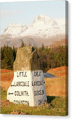 Old Stone Road Sign In Langdale Canvas Print by Ashley Cooper
