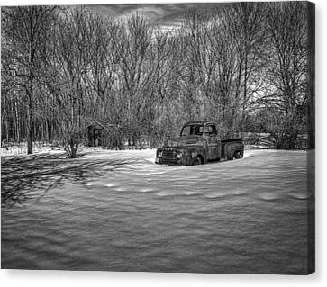 Old Timer In The Snow Canvas Print by Thomas Young