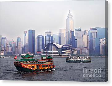 Old Traditional Chinese Junk In Front Of Hong Kong Skyline Canvas Print by Lars Ruecker