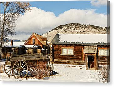 Old Wagon And Ghost Town Buildings Canvas Print by Sue Smith