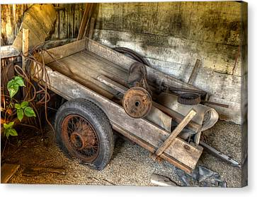Old Wagon In The Barn Canvas Print