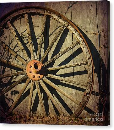 Old West Wagon Wheel Canvas Print by Betty LaRue