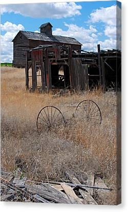 Canvas Print featuring the photograph Old Wheels And Barn by Kjirsten Collier