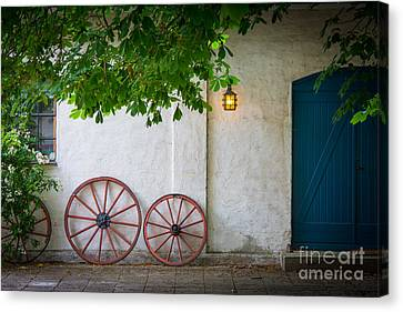 Old Wheels Canvas Print by Inge Johnsson