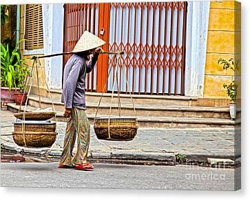 Old Woman In Hoi An Vietnam Canvas Print by Fototrav Print