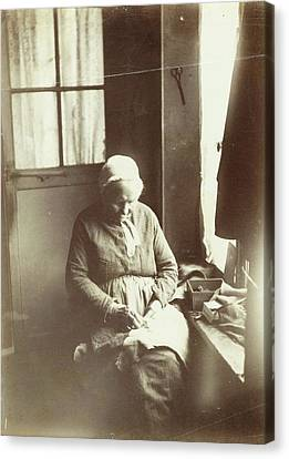 Old Woman Sitting By A Window Sewing, Anonymous Canvas Print
