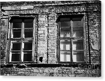 Old Wooden Double Layer Glazing In Old Red Brick Building With Plaster Facade Removed For Renovation Kazimierz Krakow Canvas Print by Joe Fox
