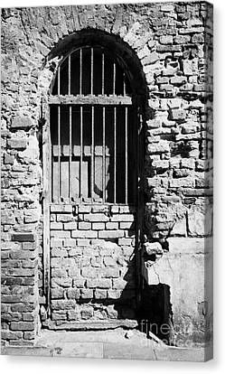 Old Wooden Framed Window With Weathered Steel Bars Door Replacement In Red Brick Building With Plaster Removed Krakow Canvas Print by Joe Fox