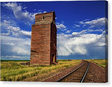 Old Wooden Granary Still Stands Canvas Print by Chuck Haney