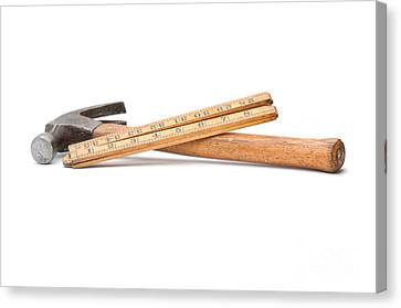 Old Wooden Rule And Hammer. Canvas Print by Stephen Baker