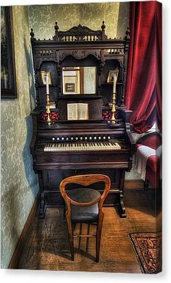 Olde Piano Canvas Print by Ian Mitchell