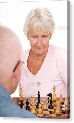Older Couple Playing Chess Canvas Print by Lea Paterson