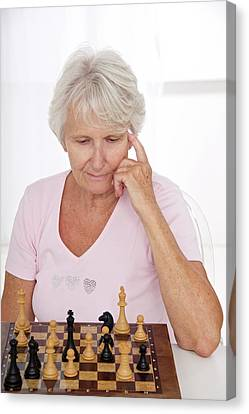 Older Lady Playing Chess Canvas Print by Lea Paterson