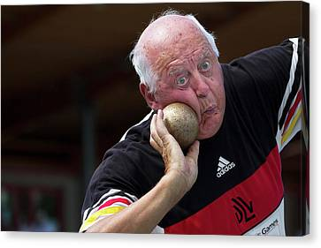 Older Man About To Throw Shot Put Canvas Print