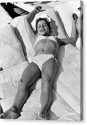 Olga Korbut Lying Down In The Sun Canvas Print by Duane Michals