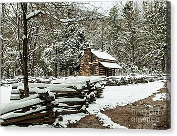 Canvas Print featuring the photograph Oliver's Log Cabin Nestled In Snow by Debbie Green