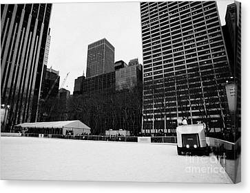 olympia zamboni ice clearer clearing the ice at Bryant Park ice skating rink new york city Canvas Print by Joe Fox