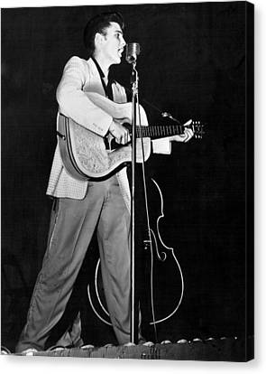 On Stage Elvis Presley Plays And Sings Canvas Print by Retro Images Archive