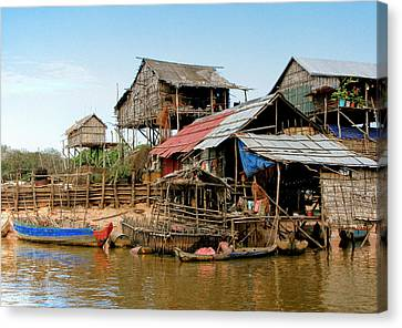 Bamboo House Canvas Print - On The Shores Of Tonle Sap by Douglas J Fisher